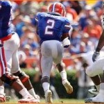 Demps helps Gators run over Bulls 38-14