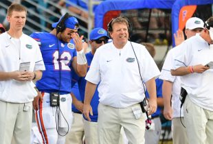 Jim McElwain says all three of Florida's quarterbacks may play vs. Michigan
